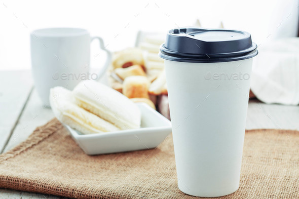Coffee cup and bread on table - Stock Photo - Images