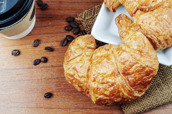 croissants and coffee on wooden - Stock Photo - Images