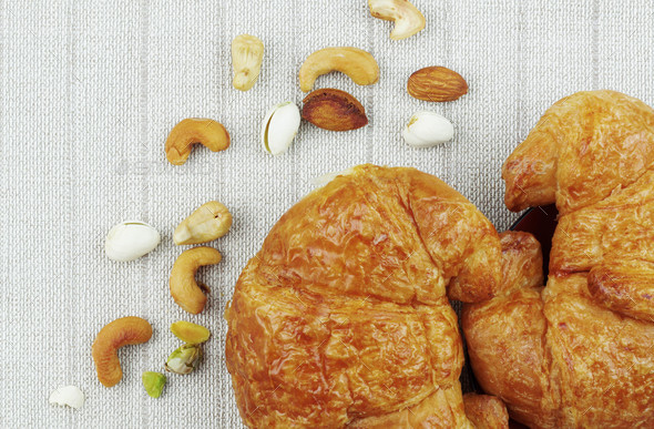 Croissants on a tablecloths - Stock Photo - Images