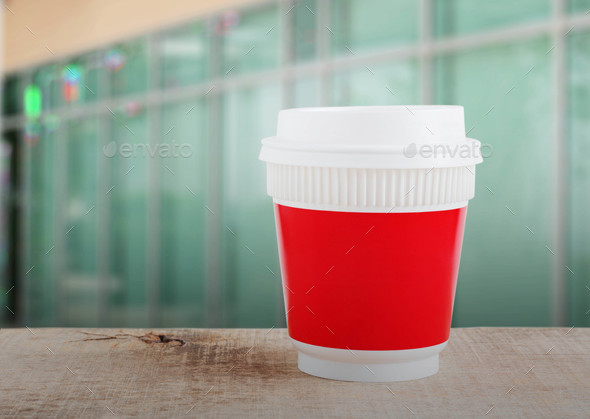 Plastic cup with office background - Stock Photo - Images