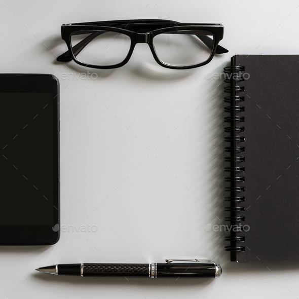 Blank notebook with smart phone and laptop desk office - Stock Photo - Images