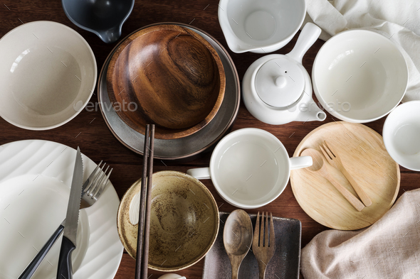 Many empty dishes and plates on wooden background - Stock Photo - Images