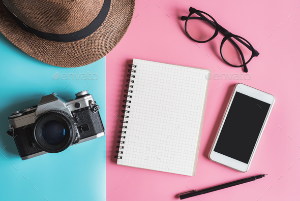 Flat lay fashion style with camera, smart phone, notebook and hat - Stock Photo - Images