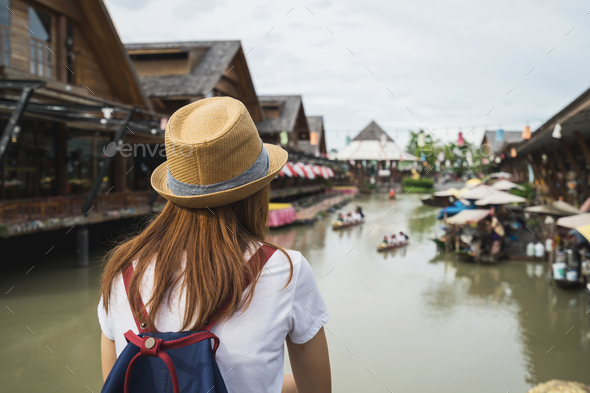 Young woman travel at floating market in Thailand - Stock Photo - Images