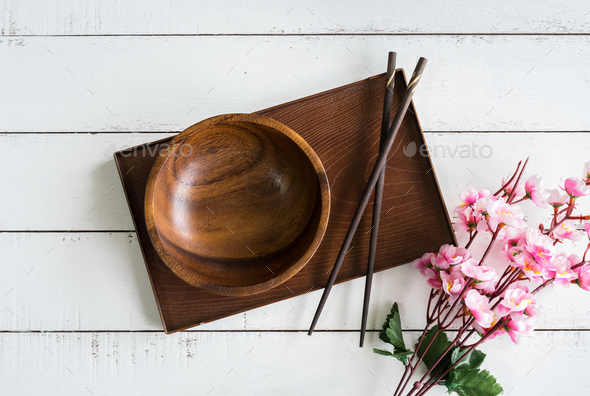 Wooden bowl with chopsticks on wooden table - Stock Photo - Images