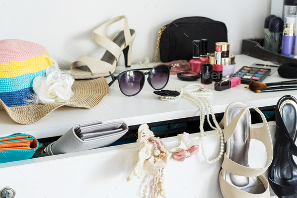 woman's dressing table with cosmetics set and fashion accessories - Stock Photo - Images