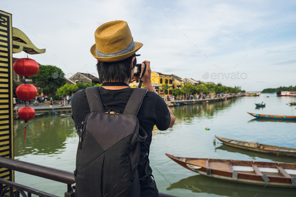 Young asian traveler with backpack at Hoi An ancient town - Stock Photo - Images