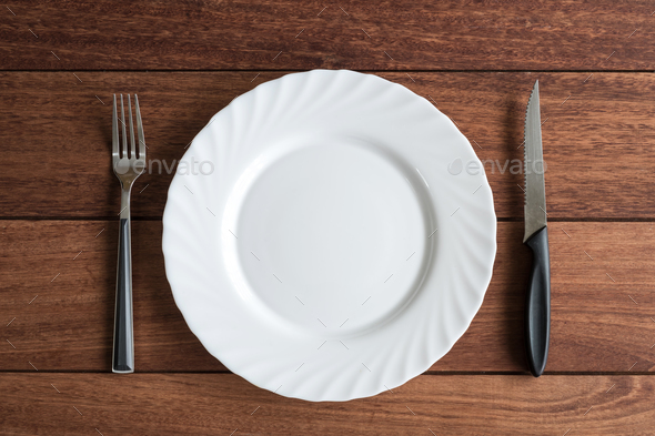 Empty plate with knife and fork, Top view - Stock Photo - Images