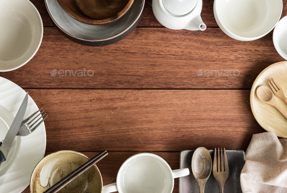 Empty dishes on wooden background with copy space - Stock Photo - Images
