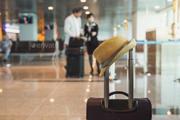 Travel suitcase in airport terminal - Stock Photo - Images