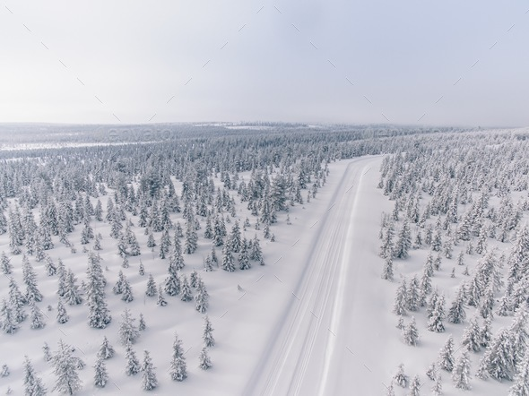 Aerial view of the road in the winter snow forest in Finland - Stock Photo - Images