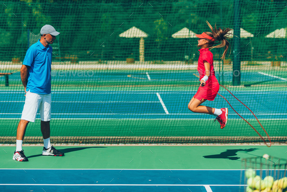 Tennis girl jumping rope - Stock Photo - Images