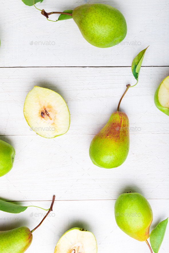 Pears background on white wooden table. - Stock Photo - Images