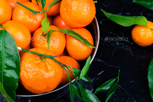 Tangerines background. Delicious and beautiful Citrus. - Stock Photo - Images