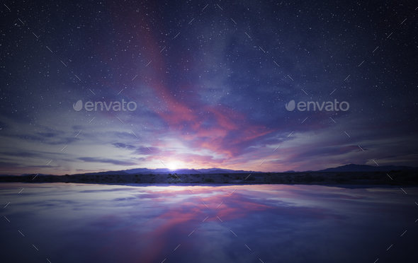 idyllic sunrise in the sky reflecting on calm water - Stock Photo - Images