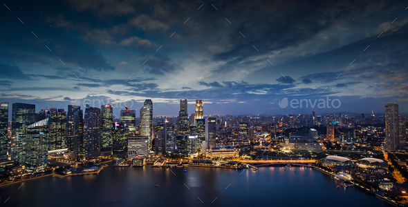 modern buildings illuminated in Singapore downtown  at dusk - Stock Photo - Images