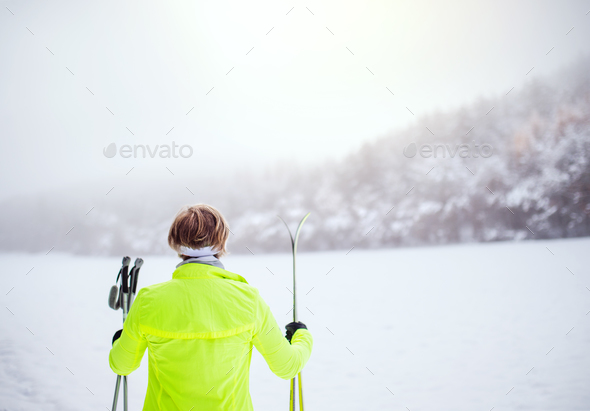 Senior woman going cross-country skiing. - Stock Photo - Images