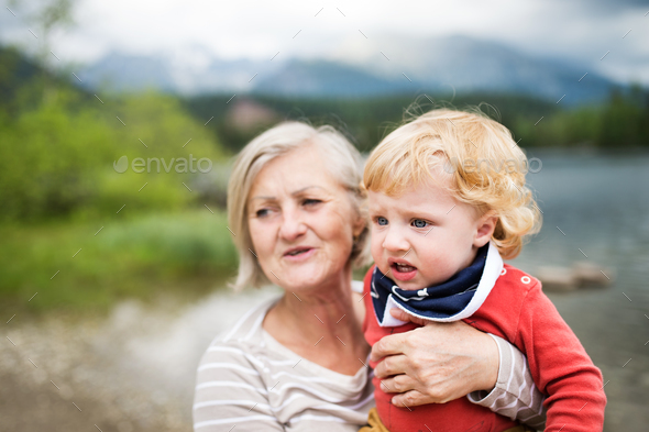 Senior woman with little boy at the lake, summer day. - Stock Photo - Images