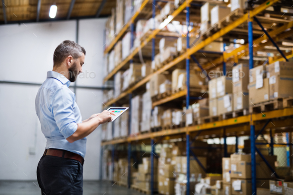 Man warehouse worker with a tablet. - Stock Photo - Images