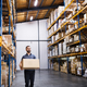Male warehouse worker with a large box. - PhotoDune Item for Sale