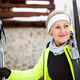 Senior woman getting ready for cross-country skiing. - PhotoDune Item for Sale