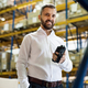 Warehouse worker or supervisor with barcode scanner. - PhotoDune Item for Sale