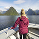 Girl on Boat with Fjords, Milford Sound, New Zealand - VideoHive Item for Sale