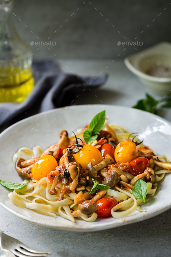 Fettuccine with Mushroom and Tomatoes sauce - Stock Photo - Images
