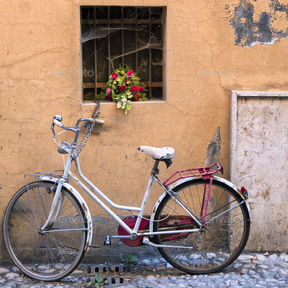 Rieti (Italy), white bicycle and flowers - Stock Photo - Images