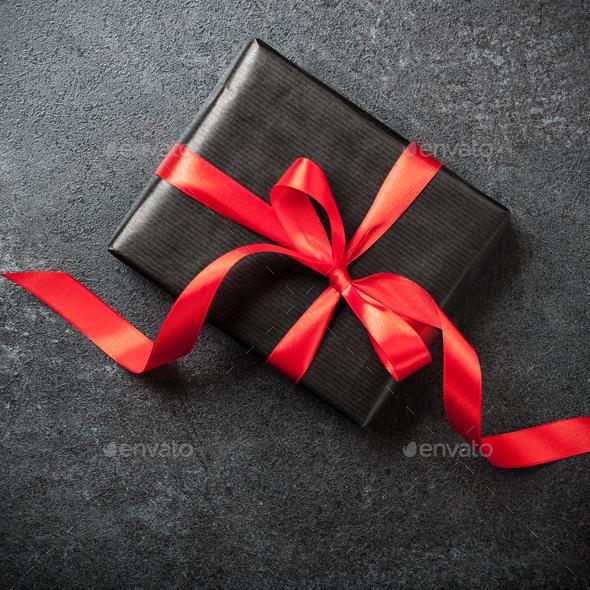 Gift box on black background - Stock Photo - Images