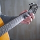 Guitarist Plays on the Acoustic Western Guitar with Steel Strings Spanish Random Chords - VideoHive Item for Sale