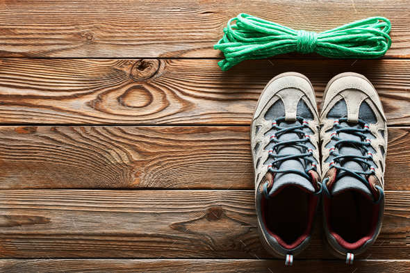 Hiking shoes and climbing rope - Stock Photo - Images