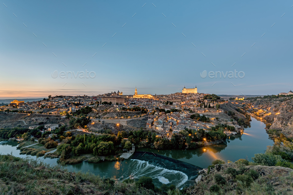 View of Toledo with the Tagus river after sunset - Stock Photo - Images