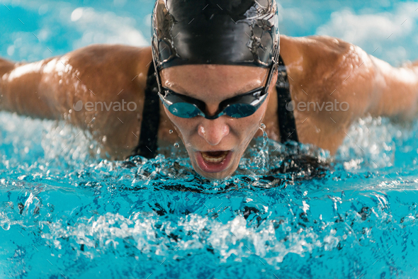 Professional swimmer, swimming race, indoor pool - Stock Photo - Images
