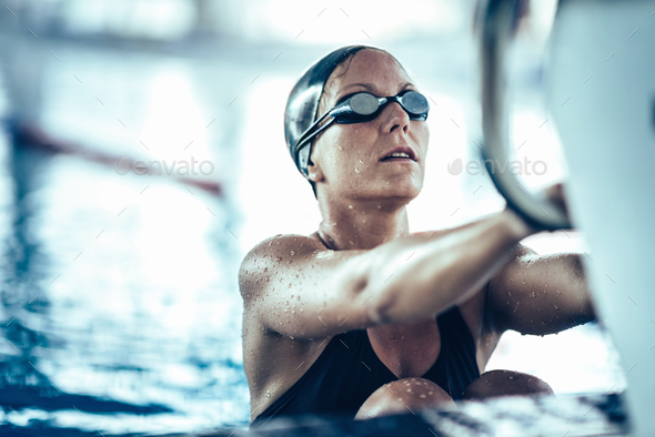 Professional swimmer in training, indoor swimming pool - Stock Photo - Images