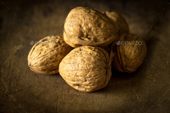 Whole walnuts on wooden table - Stock Photo - Images