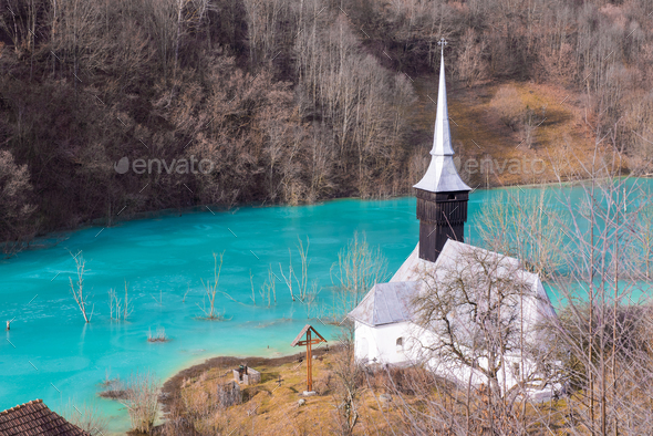 Church and flooded cemetery next to drowned village at Geamana lake near gold mine of Rosia Montana - Stock Photo - Images