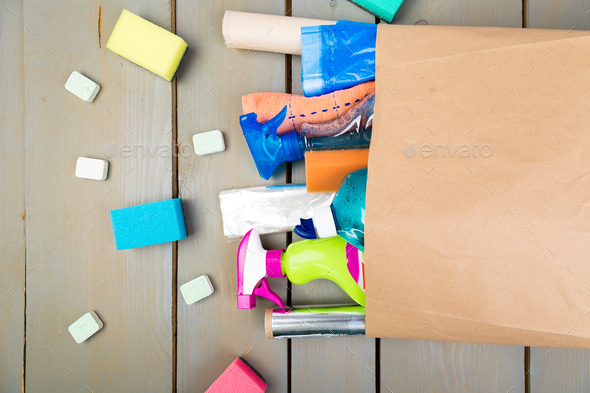 Full paper bag of different house cleaning product - Stock Photo - Images