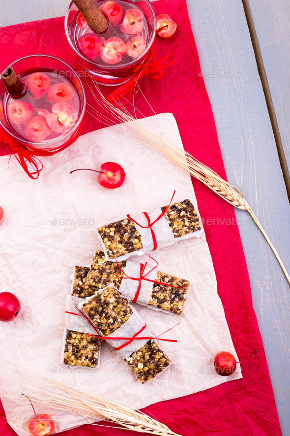Diet muesli bars with detox apple cinnamon water - Stock Photo - Images