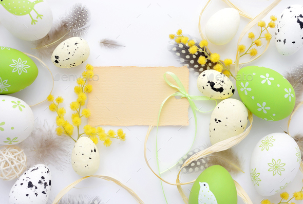 Easter eggs and mimosa flowers on white background with blank ca - Stock Photo - Images