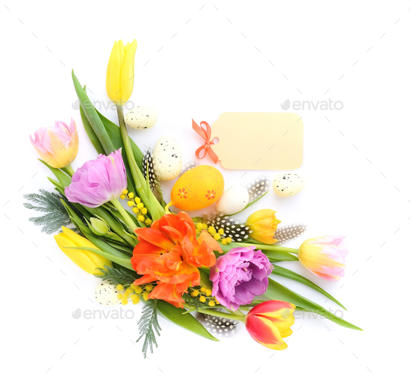 Colorful tulips with easter eggs on white background. Top view. - Stock Photo - Images