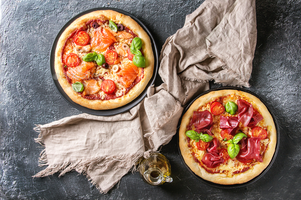 Pizza with bresaola and salmon - Stock Photo - Images
