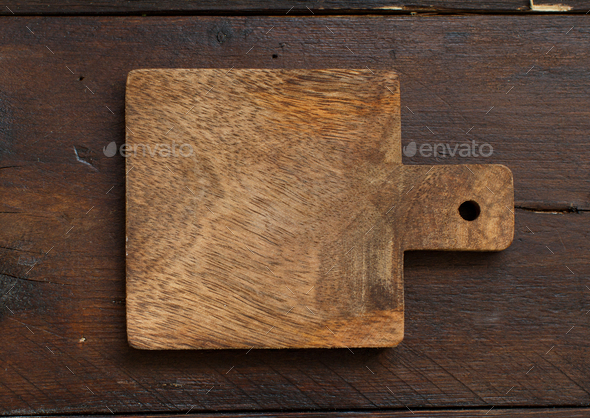 Wooden table and old cutting board - Stock Photo - Images