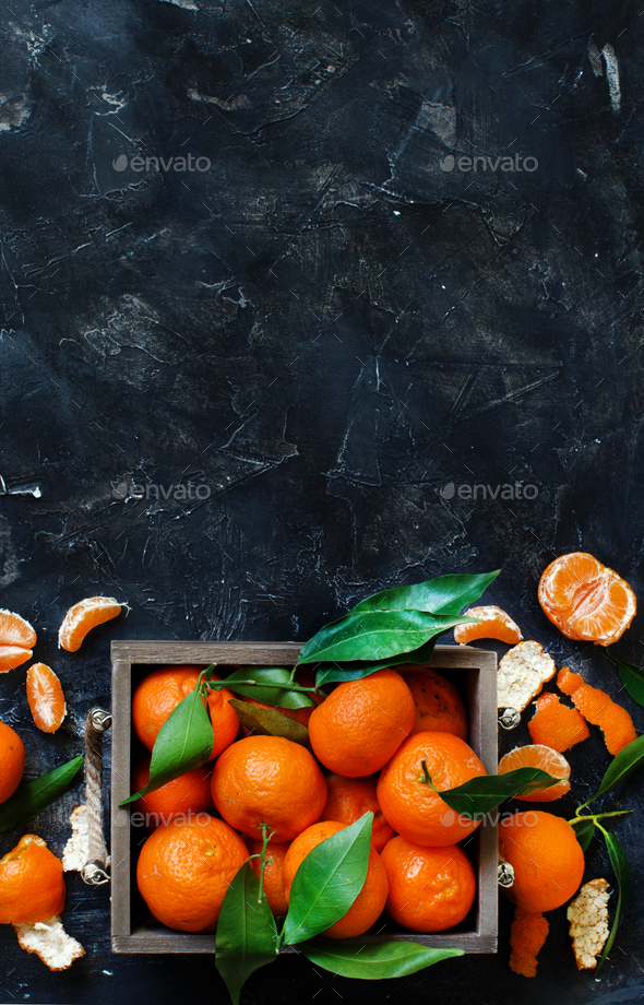 Mandarins with leaves in a box - Stock Photo - Images