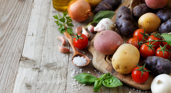 Raw potatoes and vegetables - Stock Photo - Images