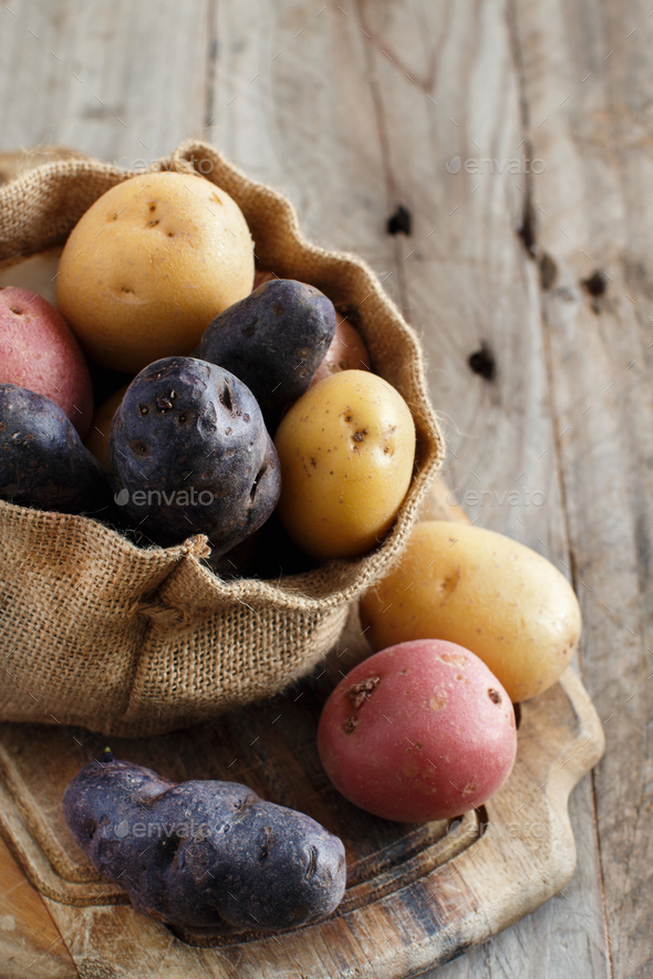 Raw multicolored potatoes - Stock Photo - Images
