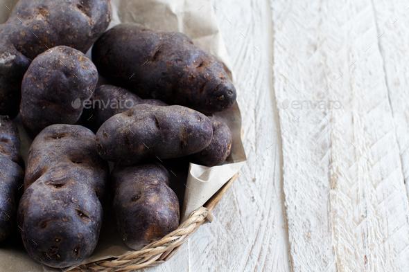 Raw purple potatoes - Stock Photo - Images