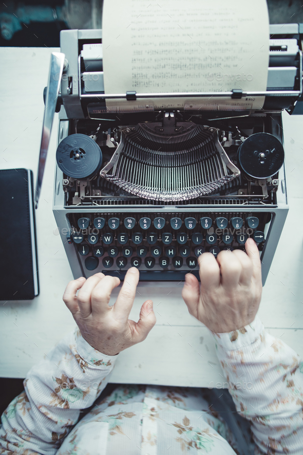 Writer typing with retro writing machine. - Stock Photo - Images