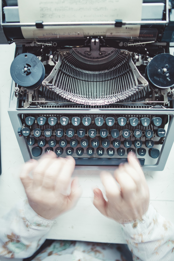 Writer typing with retro writing machine. - Stock Photo - Images