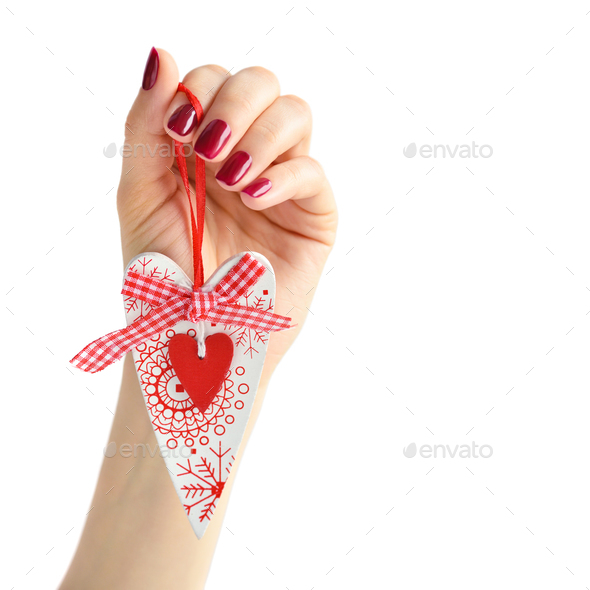 Heart handmade in hand of girl with red manicure on white backgr - Stock Photo - Images